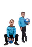 Cute sporty twin brothers  on white Royalty Free Stock Photography