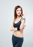 Cute sporty woman showing ok sign Royalty Free Stock Image