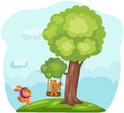 Cute squirrels playing tree swing Royalty Free Stock Image