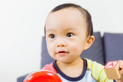 Cute ssian baby boy playing toy Stock Images