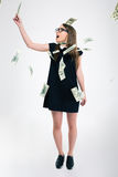 Cute standing under rain with dollar bills Stock Image