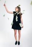 Cute standing under rain with dollar bills Stock Image