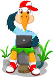 Cute stork cartoon playing computer Stock Images