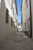 Cute street in city Pag in Croatia Royalty Free Stock Photo