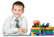 Cute student with books and pencils Stock Photo