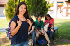 Cute student with friends Royalty Free Stock Photography