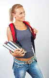 Cute student girl holding books. Portrait of a smiling casual young female, education and back to school concept Royalty Free Stock Photography