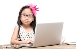 Cute student girl with laptop computer on the table  Royalty Free Stock Images