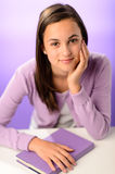 Cute student girl with purple book Stock Image