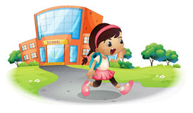 A cute student going home from school Royalty Free Stock Image