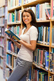 Cute student holding a book Stock Photography
