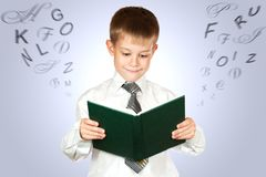 Cute student is holding book.  Stock Images