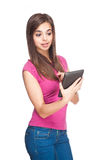 Cute student holding tablet computer. Royalty Free Stock Image