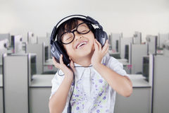 Cute Student Listening Music with Headphones Stock Photos