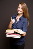 Cute student showing thumbs up. Portrait of a cute young brunette student showing thumbs up Stock Images