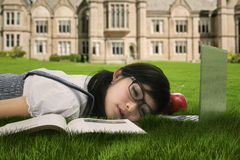 Cute student sleeping on the grass 1 Stock Image