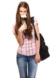 Cute student smells a flower Royalty Free Stock Photos