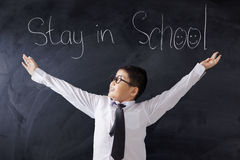 Cute student with text of Stay in School Stock Photo