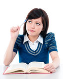 Cute Student Thinking. Portrait of an attractive young Asian female student thinking royalty free stock photos