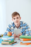 Cute student using tablet computer Stock Images
