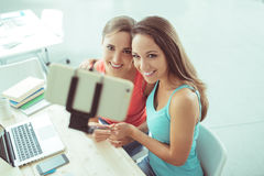 Cute students taking selfies at school Stock Photography
