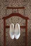 Cute stylish beige high heels with a bow on the background room, glamor, fashion, wedding Stock Image