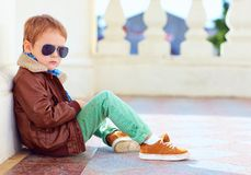 Cute stylish boy in leather jacket and gum shoes. Portrait of cute stylish boy in leather jacket and gum shoes stock images