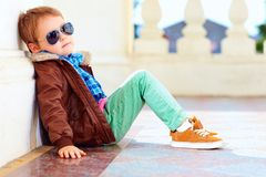 Cute stylish boy in leather jacket and gum shoes. Portrait of cute stylish boy in leather jacket and gum shoes Royalty Free Stock Photography