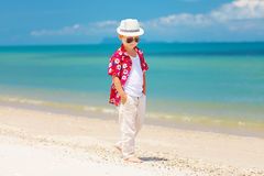 Cute stylish boy walking summer beach Stock Images