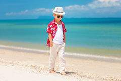 Cute stylish boy walking summer beach Stock Photography