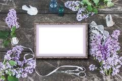 Cute and stylish branding mockup photo wit lilac. Stylish branding mockup to display your artworks. Cute vintage mock up on wooden background. Flat lay top view royalty free stock photography
