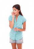 Cute stylish female in short jeans whispering Royalty Free Stock Photo
