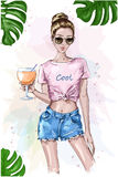 Cute stylish girl in crop top. Summer look. Fashion woman holding cocktail drink glass. Sketch. Summer set with green leaves. Stock Photos