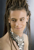 A cute stylish handsome guy with dreadlocks and jewelry Royalty Free Stock Image