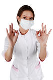 Cute successful brunette in white medical gown Royalty Free Stock Photos