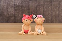 Cute icing babies in fancy dress. Cute sugarpaste babies in animal fancy dress stock images