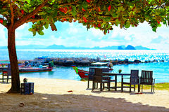 Cute summer cafe under the tree shadow, tropical seaside Royalty Free Stock Photos