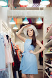 Cute Summer Fashionista Girl in Fashion Store Royalty Free Stock Photos