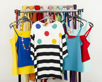 Cute summer outfits displayed on a rack. Royalty Free Stock Photo