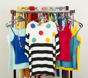 Cute summer outfits displayed on a rack. Royalty Free Stock Images