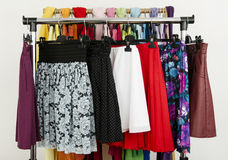 Cute summer skirts displayed on a rack. Stock Photo