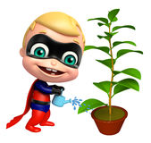 Cute superbaby with Watering can and plant Stock Photo