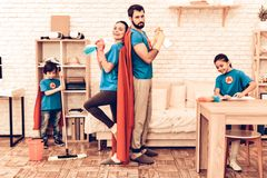 Cute Superhero Family Cleaning House with Kids. Mother with Kids Washing at Home. Cleaning Day Concept. Cosplay Superheroes. Kids Helping House Chores. Parent stock photo