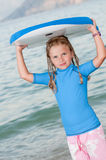 Cute surfer. Summer vacation - little surfer at the beach Royalty Free Stock Photos