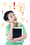 Cute surprised asian boy with tablet computer on isolated backgr Stock Photo