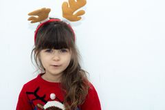 Cute surprised child in Santa Claus hat, Emotions. Funny Laughing child Portrait. royalty free stock photography