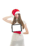 Cute surprised teenage girl showing tablet computer Royalty Free Stock Images