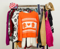 Cute sweaters displayed on a rack. Stock Images
