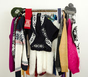 Cute sweaters with snowflakes displayed on a rack. Royalty Free Stock Photos