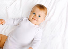 Cute sweet baby lying on the bed Stock Photo